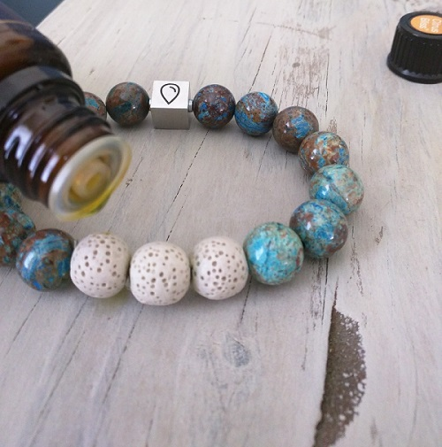 Add drop of essential oil to bracelet