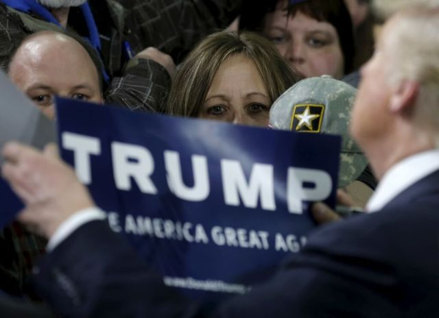 Supporters wait to get an autograph from U.S. Republican presidential candidate Donald Trump at a campaign rally in Cadillac, Michigan, March 4, 2016. REUTERS/Jim Young