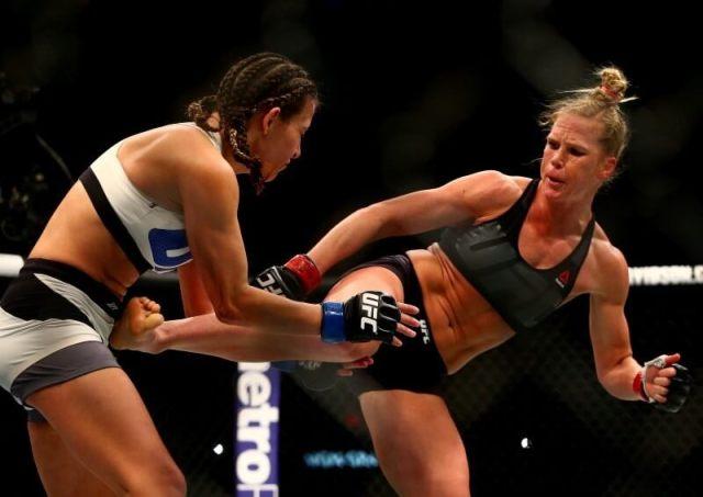 March 5, 2016; Las Vegas, NV, USA; Holly Holm lands a kick against Miesha Tate during UFC 196 at MGM Grand Garden Arena. Mandatory Credit: Mark J. Rebilas-USA TODAY Sports