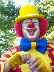 Ubi in full makeup and dress stripes.