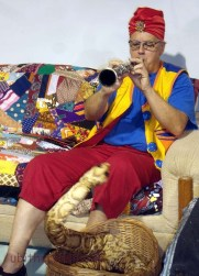 Snake charmer works his magic. That's a real clarinet.