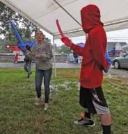Balloon swordfighting in the tent.