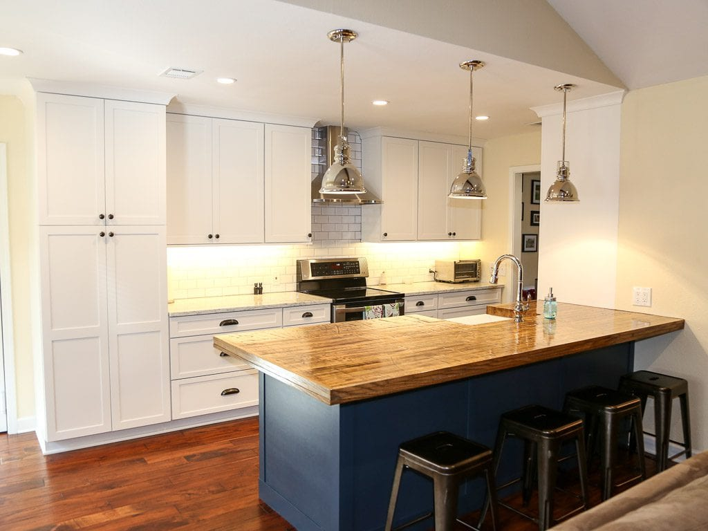 The Dominion Contemporary White Kitchen With Blue Island
