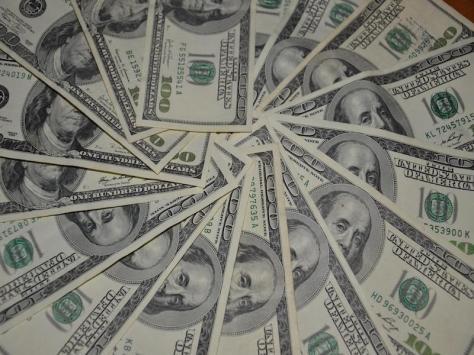 $100,000 USD