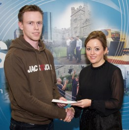 Barry Ring receiving his prize from Linda Ryan, Bank of Ireland