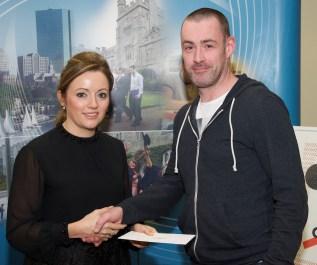 Robert Lester receiving his award from Linda Ryan, Bank of Ireland