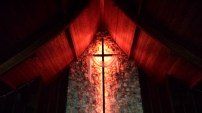 This is the Sanctuary Cross in the dark upclose