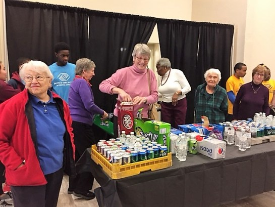 Members of UCF serving drinks to guests at 2017 MLK Jr. Birthday celebration