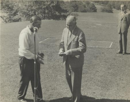 - W.R. Tracy speaking on the first tee before the start of the F.X. Coakley Memorial Tournament, sponsored by the Professional Golfers' Association. September 1945