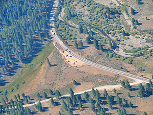 Aerial view of wildlife underpass under construction. The area's topography is too gentle to funnel animals to cross the road at a particular point. Instead, the Highway 89 Stewardship Team had to analyze years of carcass data and other information to determine the highest priority location for a crossing structure. Photo by Sara Holm, California Department of Fish and Game (CDFG)/Highway 89 Stewardship Team.Photo courtesy of Sandra Jacobson.