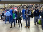 Volunteers were stationed inside the entrances of Gampel Pavilion to greet fans and welcome them to Green Game Day.