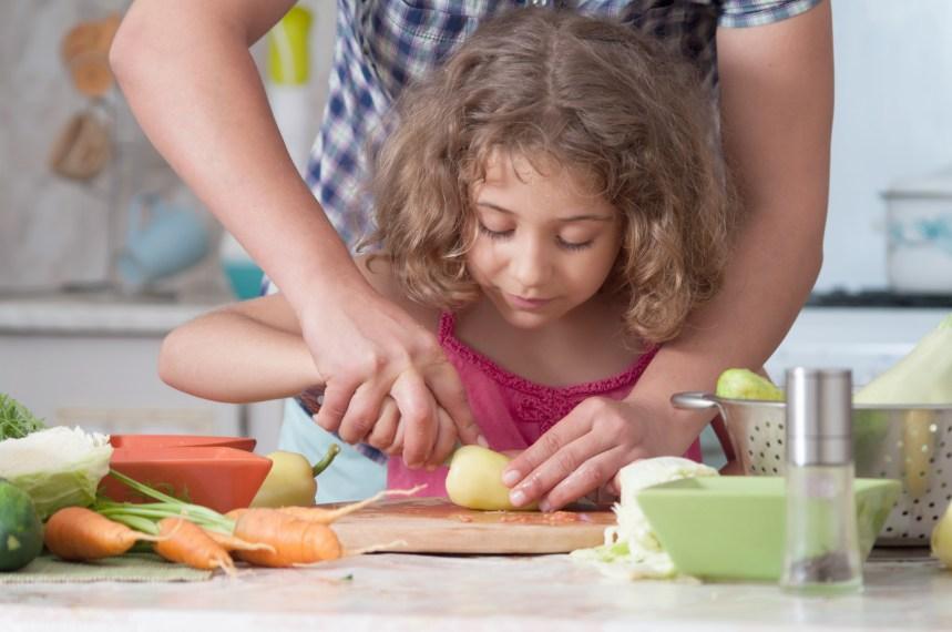 girl preparing healthy food vegetable salad