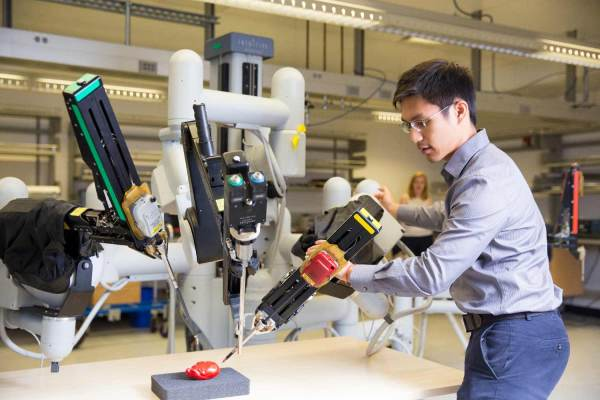 Engineers Developing Advanced Robotic Systems