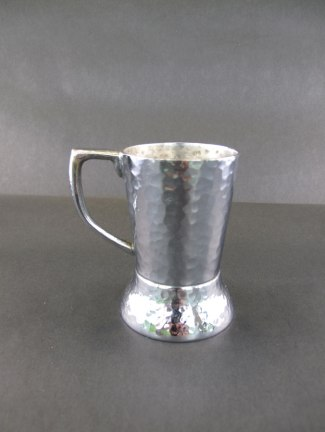 Hammered silver cup holder with handle, ca. 1933. (Hugh Moore Dixie Cup Company Collection, Special Collections and College Archives, Skillman Library, Lafayette College.)