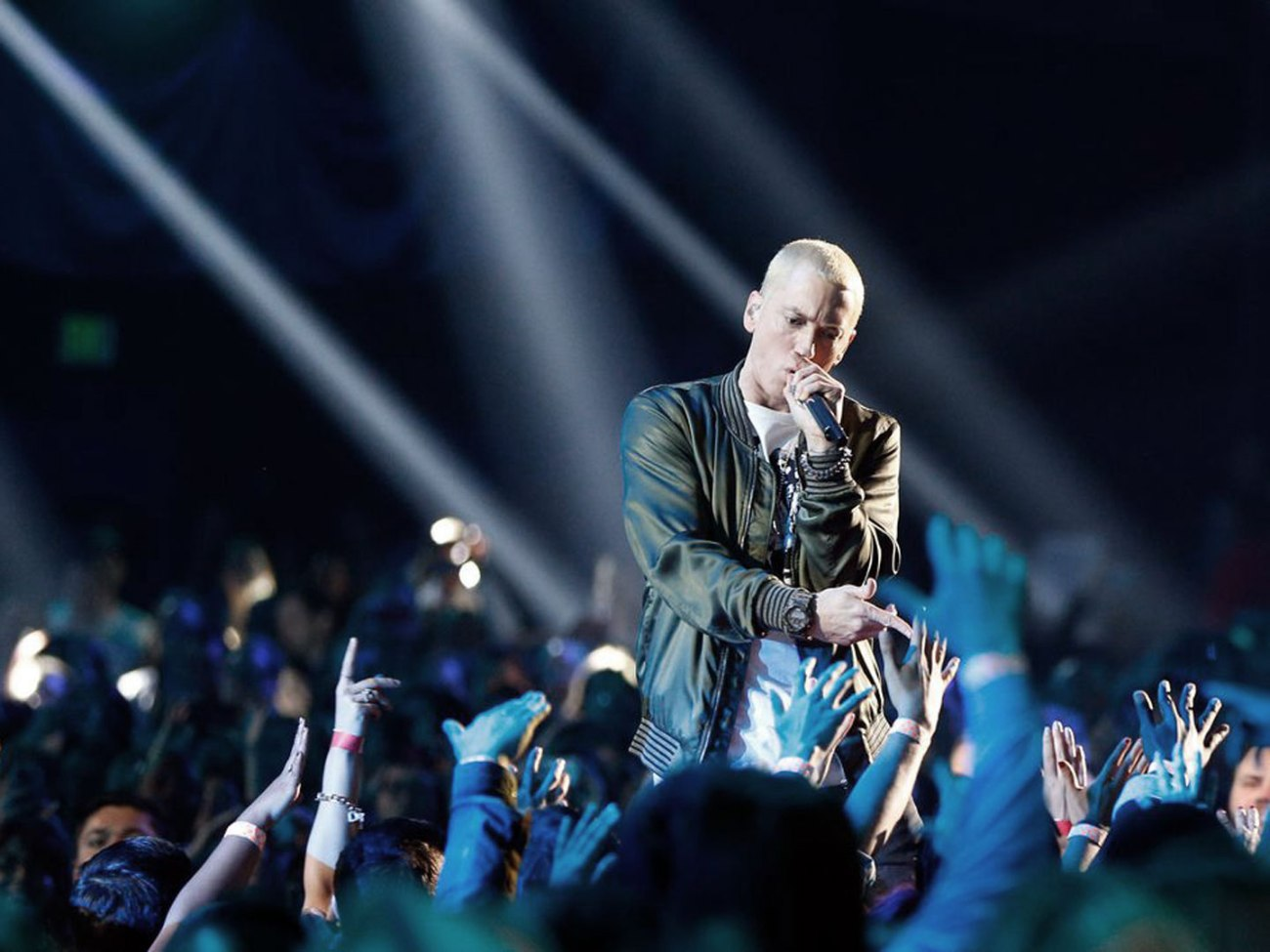 Eminem performs onstage at the 2014 MTV Movie Awards at Nokia Theatre L.A. Live