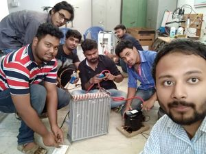 Students of University of Engineering & Management (UEM), Jaipur had taken an initiative to design and manufacture a new Air Conditioner in their own University laboratory for their teachers.  Few pictures in the post are showing the students who were working on the same.  Now, the Air Conditioner is fitted and well working in the Teachers