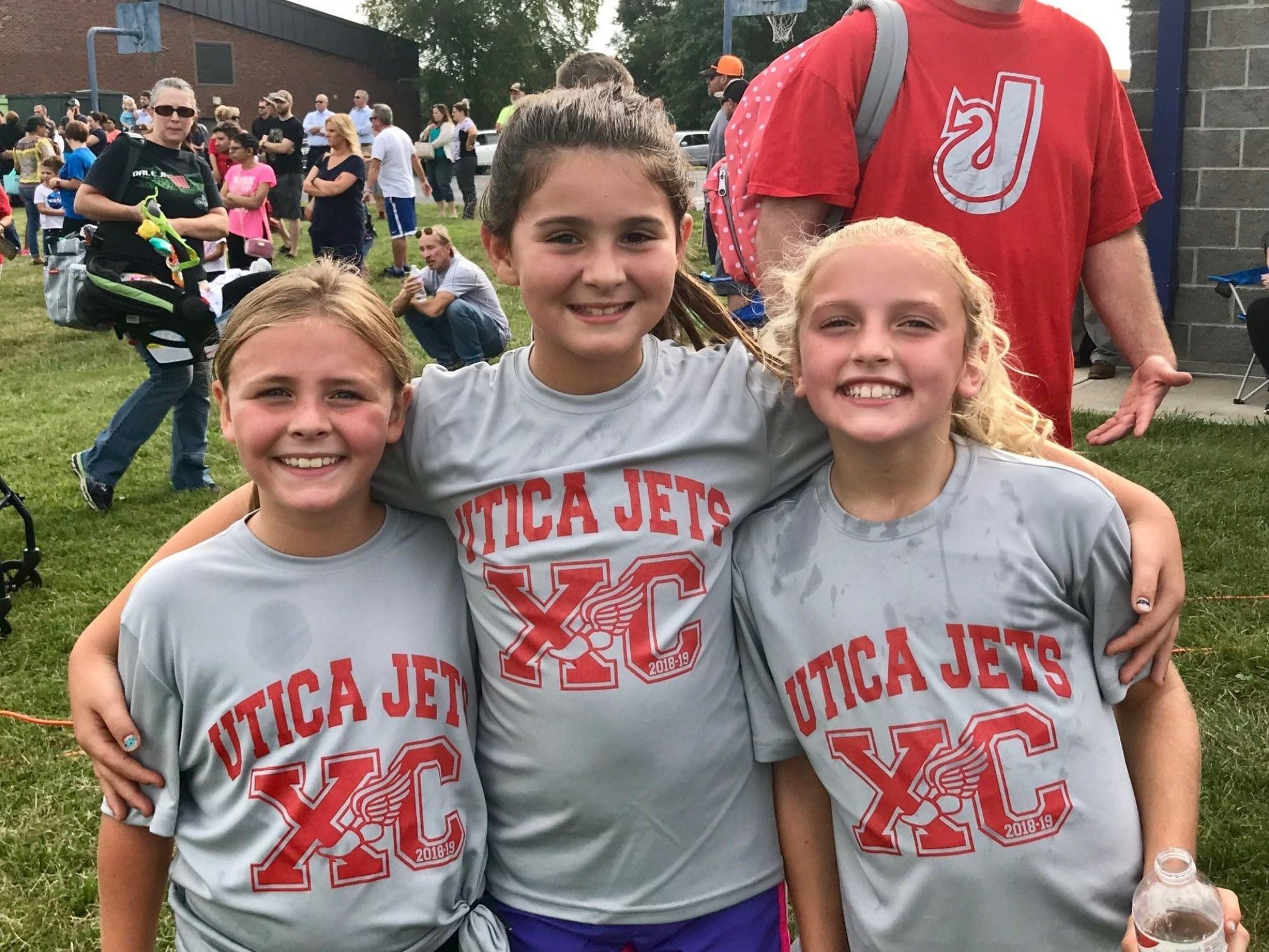 Cross-country runners pose following meet