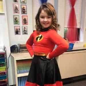 Child poses in Incredibles costume