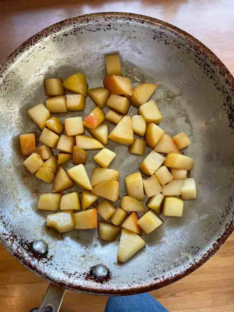 a pan full of bourbon apples