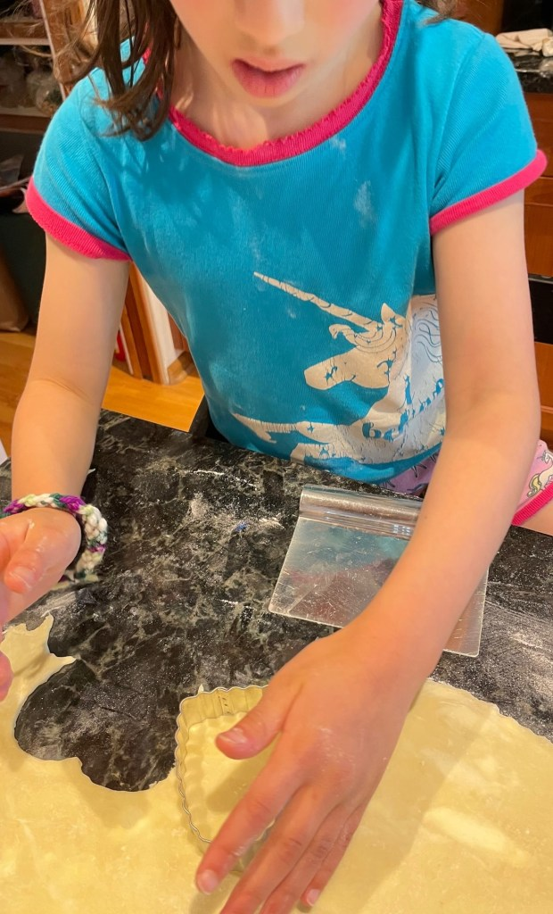 Kiddo cutting out the pop tarts using a heart shaped cookie cutter