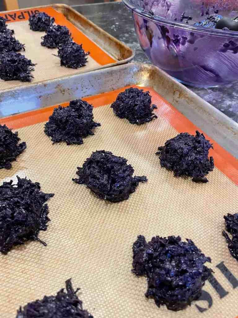 ube macaroons on a baking sheet