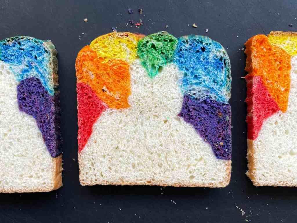 three slices of rainbow bread on a cutting board