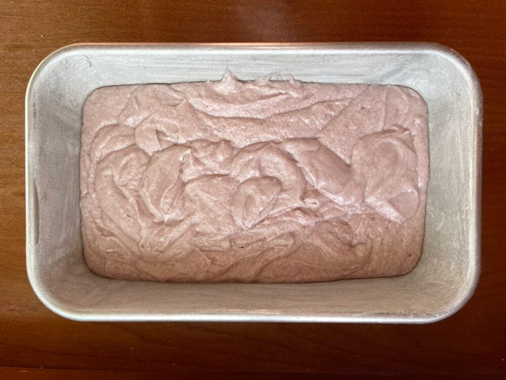 the unbaked cake in a floured cake pan