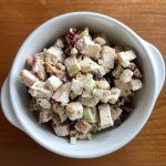 a bowl of cranberry chicken salad