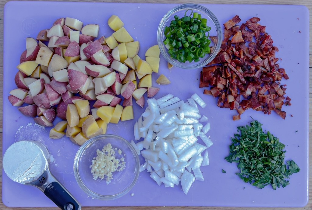 a cutting board with all of the ingredients for this sweet corn soup recipe