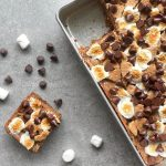 a chocolate chip marshmallow cookie bar cut from the pan