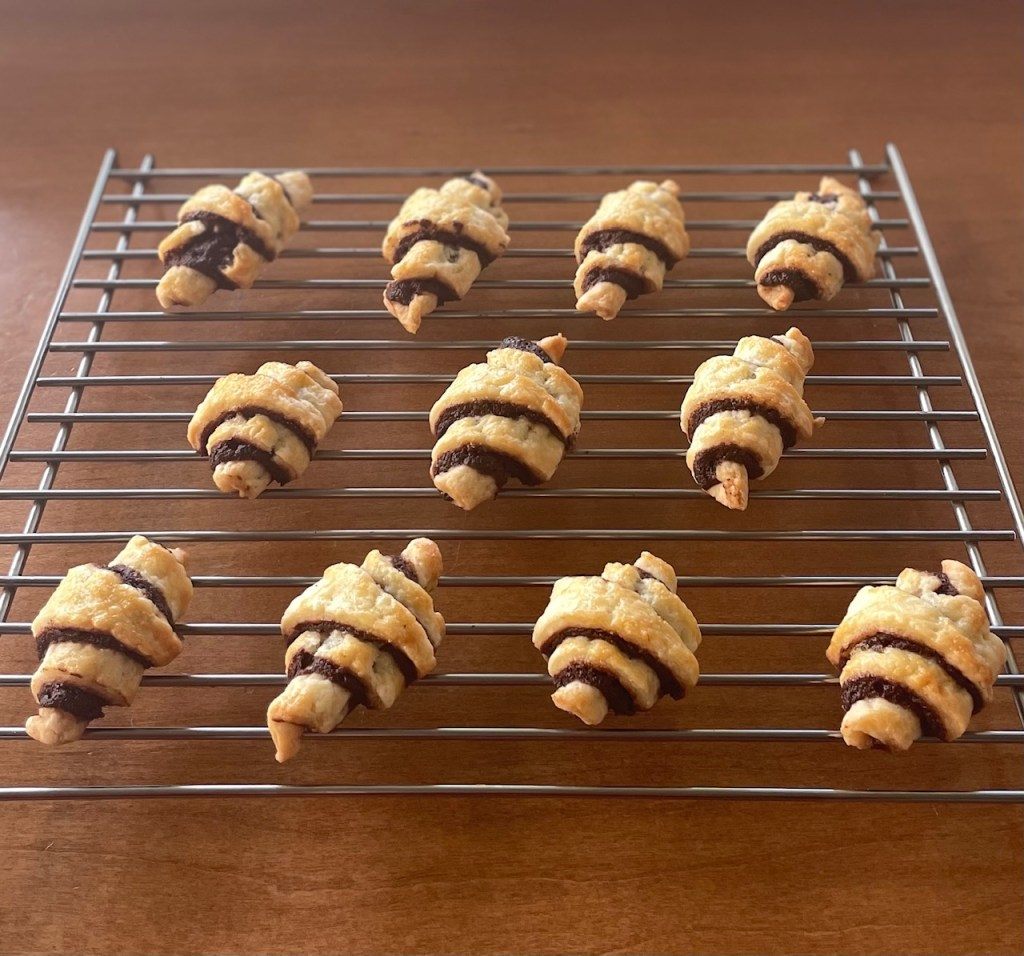 chocolate rugelach on a cooling rack