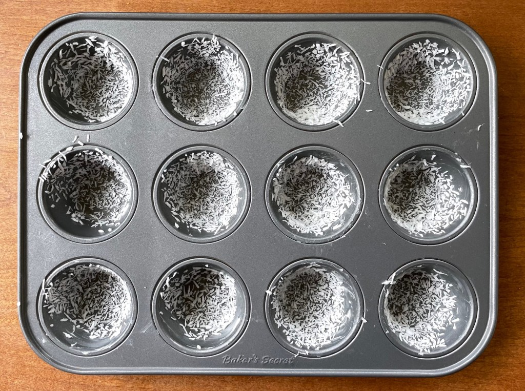a 12 cup mini muffin pan greased and lined with coconut
