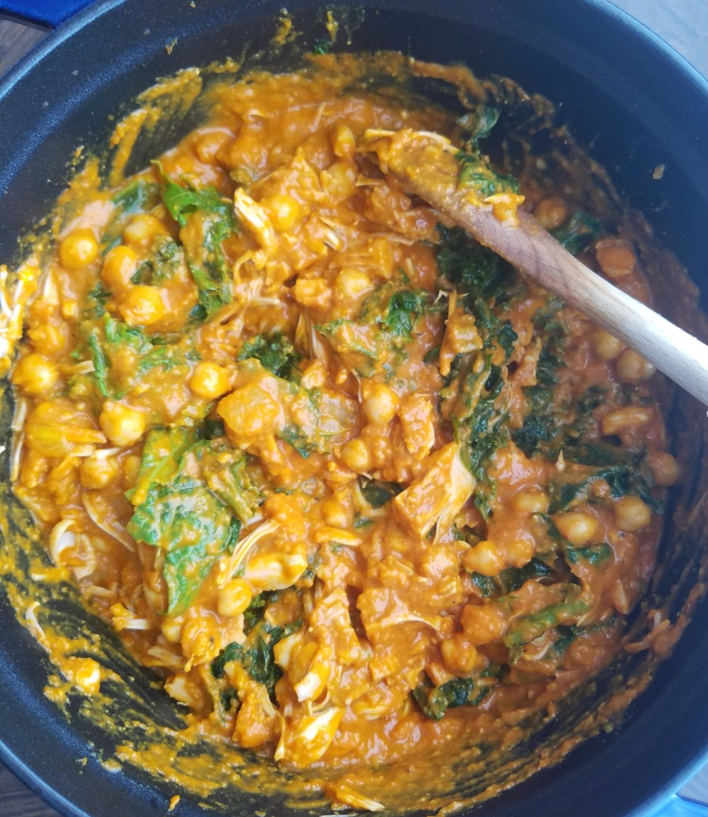 Chickpeas, jackfruit, and greens in madras curry sauce