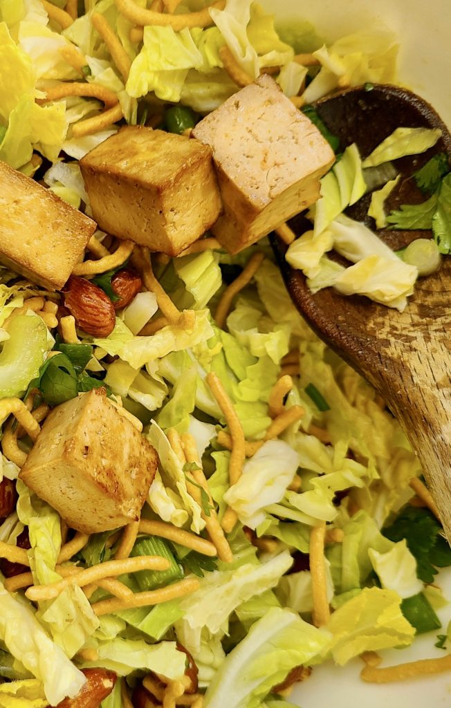 Napa cabbage, chow mein noodles, dry roasted almonds, celery, scallions and baked tofu