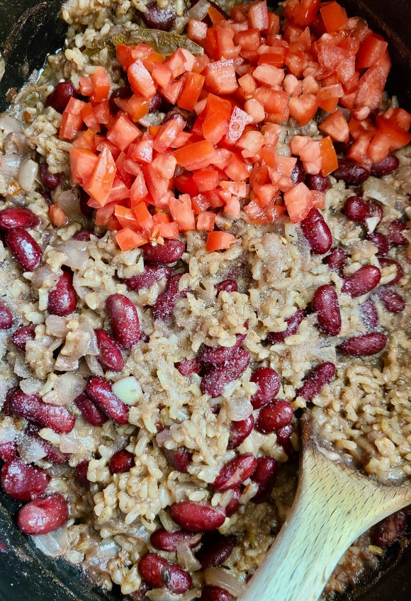 Chopped roma tomatoes on top of Vegan Slow Cooker Kidney Beans and Coconut Brown Rice