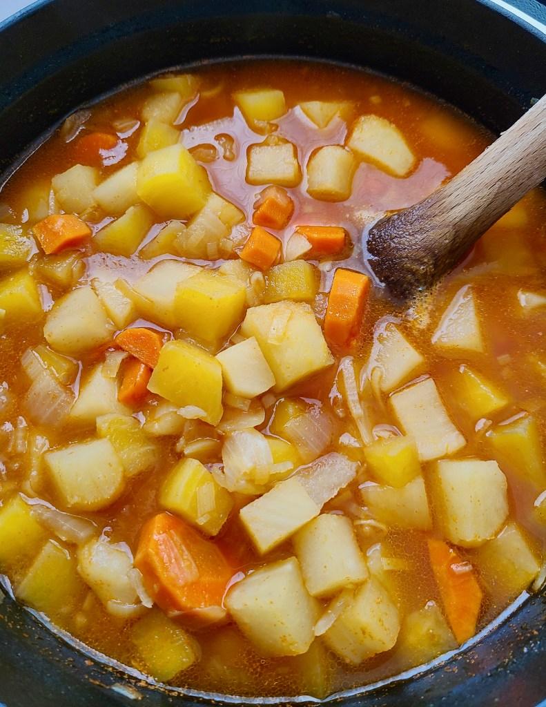 Simmering vegan golden beet soup