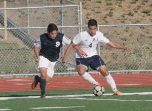 Ramin Aminian (Sr.) defends his possession of the ball.