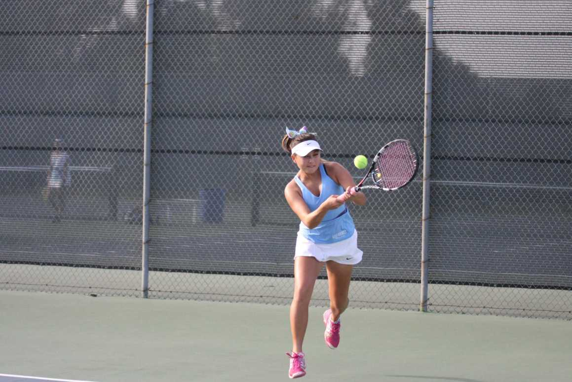 Girls Tennis team's undefeated streak broken by Peninsula High School
