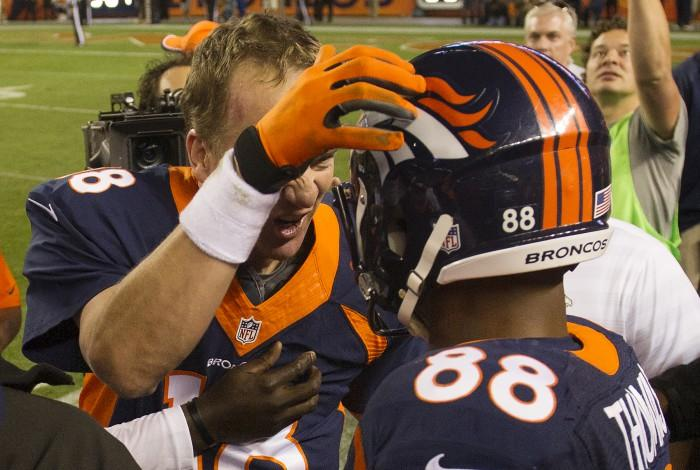 Peyton Manning and Demaryius Thomas celebrate after connecting for Manning's record 509th career touchdown pass (Mark Reis/Colorado Springs Gazette/MCT)