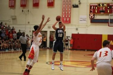 Kiron Dey (Jr.) goes for a three pointer. (Johnny Liu)