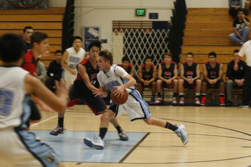 Boys basketball defeated by Beckman 85-92, struggles offensively in overtime