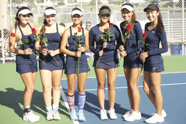 (Left to Right) Seniors Michelle Maddox, Melina Gharibian, Silke Hoffmann, Reeyah Chopra, Judy Kam, and Anja Seng pose with their Senior Day roses. (Alex Novakovic)