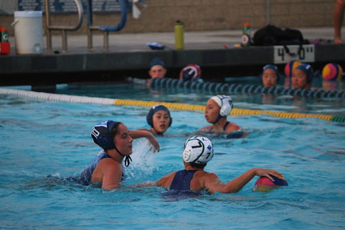 Anna Campbell (So.) fights for the ball from Irvine opponent. (L.Kamali)