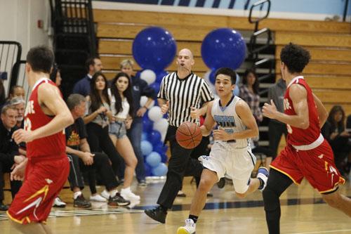 Boys Basketball falls to rival Warriors in league showdown