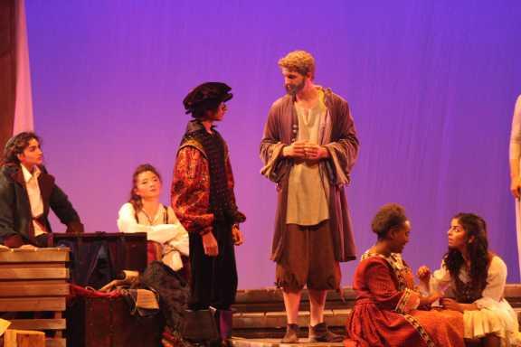 Prospero, played by Isaac Kopstein, talks to Ferdinand's dad.