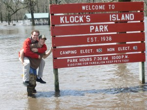 UIU alumni of 2008, Jeff Gard and Hollis Weber clown around at Klock's Island Park during the flood of 2008. They, and many other UIU students, have volunteered for river cleanup as well as used the Volga River and other water bodies for valuable research projects.