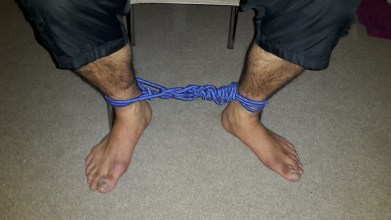 Ankles restrained with rope