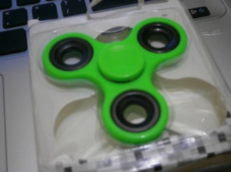 """So this is what they call """"Fidget Spinner"""" or just """"Spinner"""". It is a flat, palm-sized gadget with three arms that spin on a ball bearing. You just flick it and watch it spin around and around. It whirs quietly. Nowadays, children are into playing this toy even in class which I sometimes confiscate from them. According to an article I read online, fidget spinners may be more than just a toy. Some websites that sell them have made sweeping health claims. They say the spinners can help relieve stress, anxiety or even the symptoms of attention deficit hyperactivity disorder (ADHD). At the same time, some schools have banned the gadgets for being too distracting. So, are spinners annoying toys or therapeutic tools? It turns out, they can be both. Even I myself is so fascinated by it. I tried playing it and my boredom disappeared."""