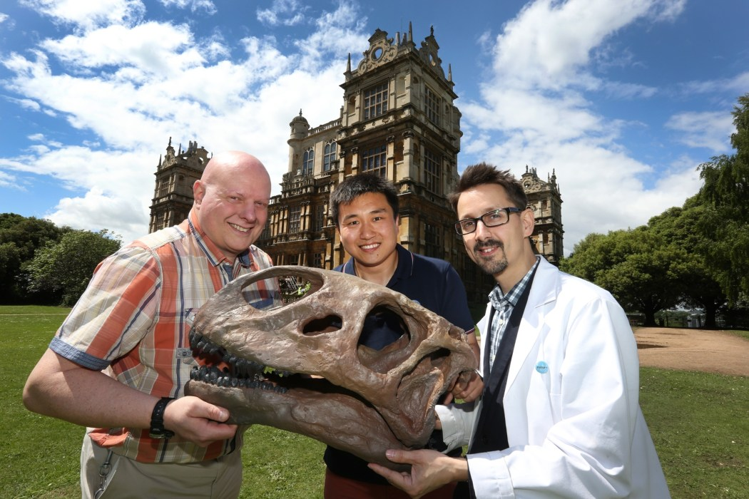 Dr Tom Hartman, Dr Wang Qi and Dr Adam Smith with the head of the Mamenchisaurus, the centrepiece of the Dinosaurs of China exhibition