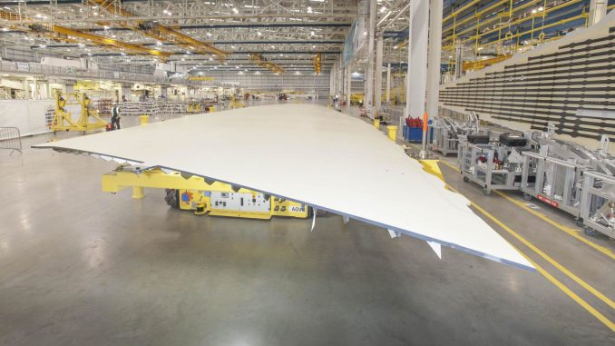 An Airbus wing cover goes into production